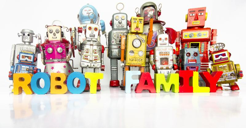 Big Family of robots with thw words ROBOT FAMILY. With wooden letters royalty free stock images