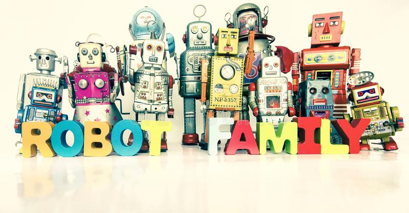 Big Family of robots with thw words ROBOT FAMILY. With wooden letters royalty free stock photo