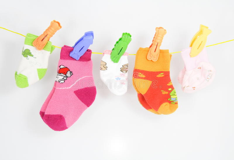 Big Family Socks. Socks of a big family with many children on the rope stock photo