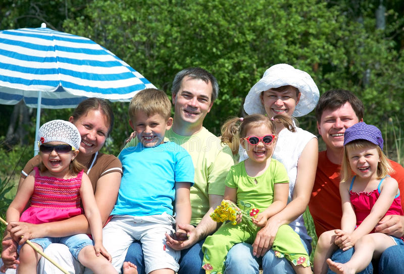 Big family on vacation stock images