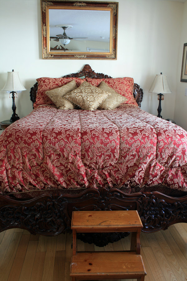 Big fancy bed royalty free stock photo