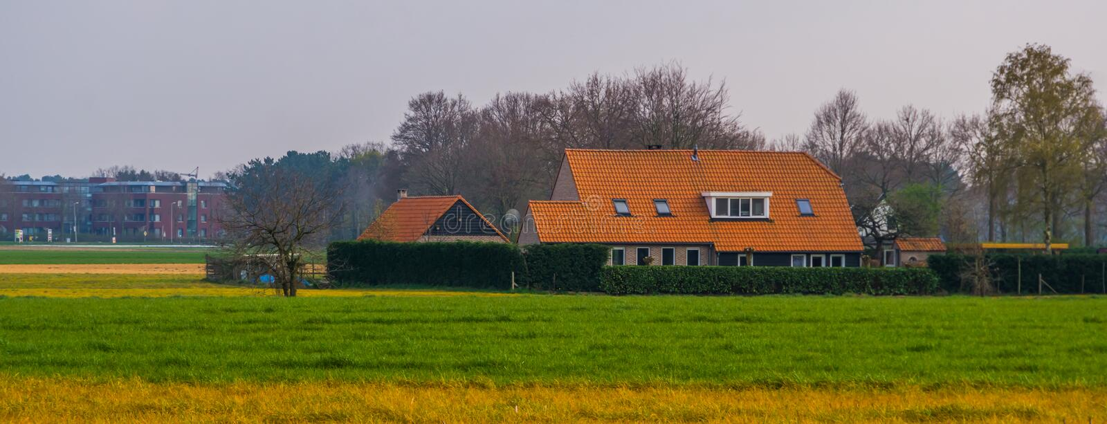 Big farmers house at the countryside, typical dutch architecture. A big farmers house at the countryside, typical dutch architecture stock photos