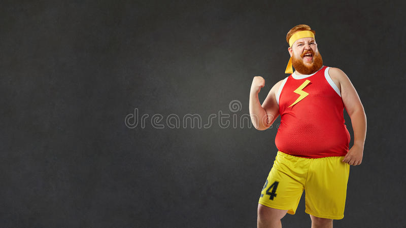 Big fat naked man in sports clothes.  royalty free stock photography