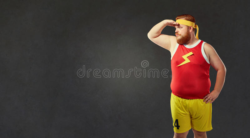 Big fat naked man in sports clothes.  stock images