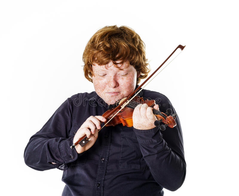 Big fat red-haired boy with small violin stock image