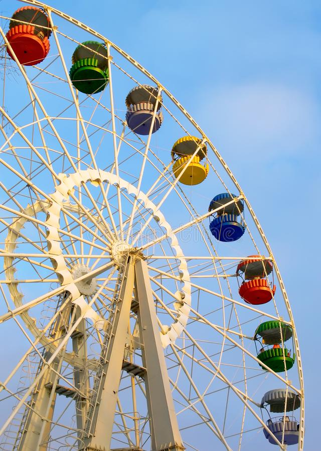 Big ferris wheel on cloudy sky stock photos