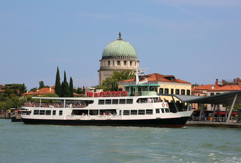 Big ferry boat called Vaporetto in Italy near a Venice stock photography