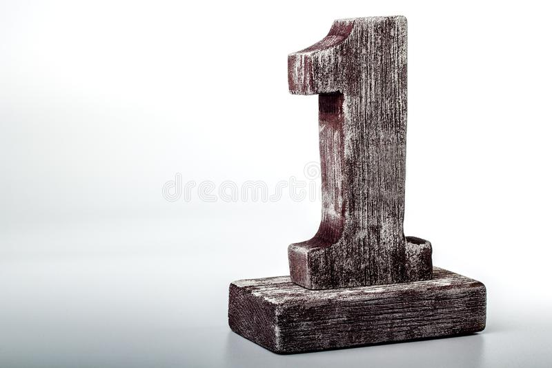 Figure one made of wood on white background stock image