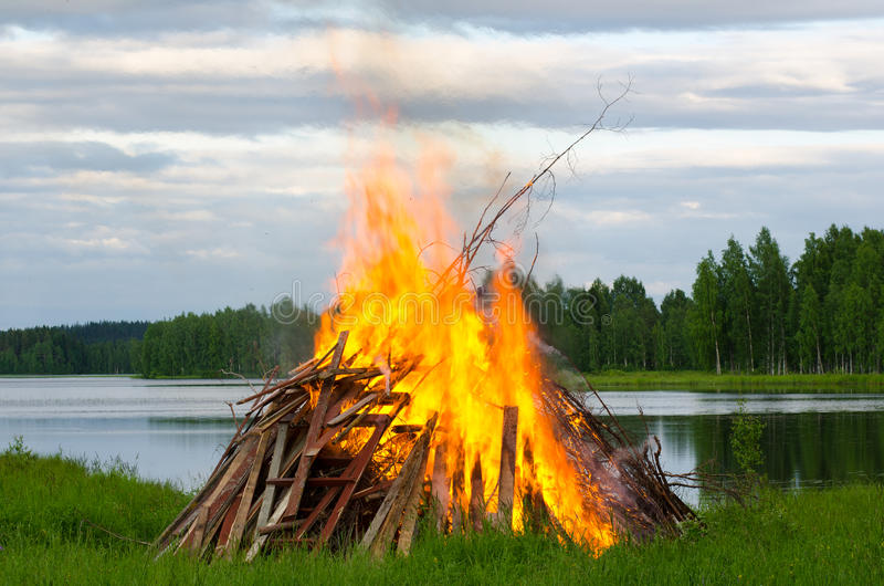 Big fire. A big fire at a lake shore on Midsummer Day, Finland stock photos