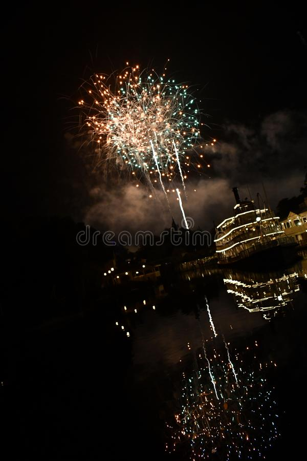 Big fire works over riverboat stock photos