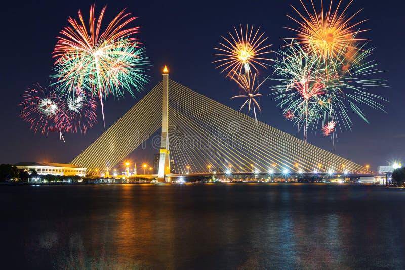 Big Fireworks at Rama VIII Suspension bridge with lighting. Reflections royalty free stock photos