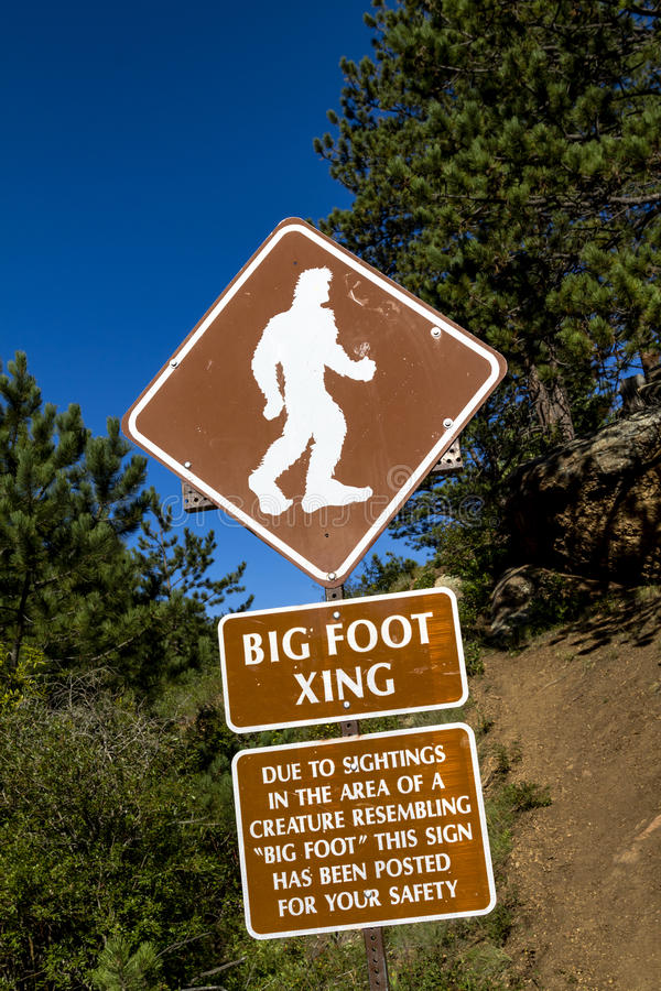 Big Foot Crossing Sign. With warning about sightings in the area royalty free stock photo