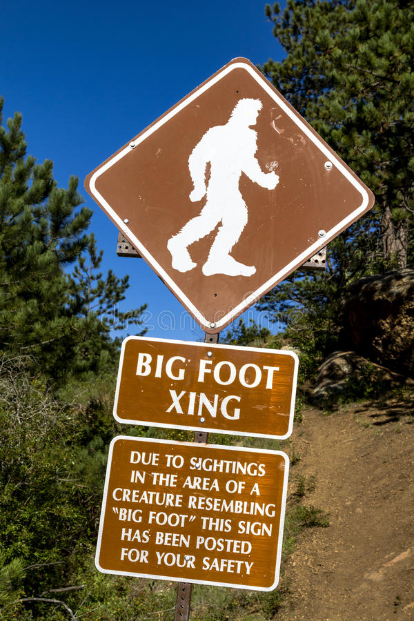 Big Foot Crossing Sign. With warning about sightings in the area stock images