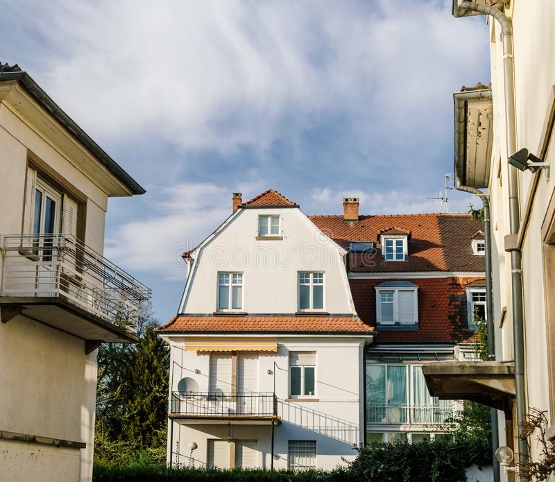 Big French real estate property house building on a warm day. With summer blue sky and scattered clouds stock photo