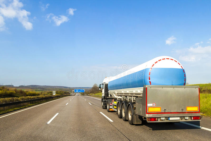 Big fuel gas tanker truck on highway royalty free stock photos
