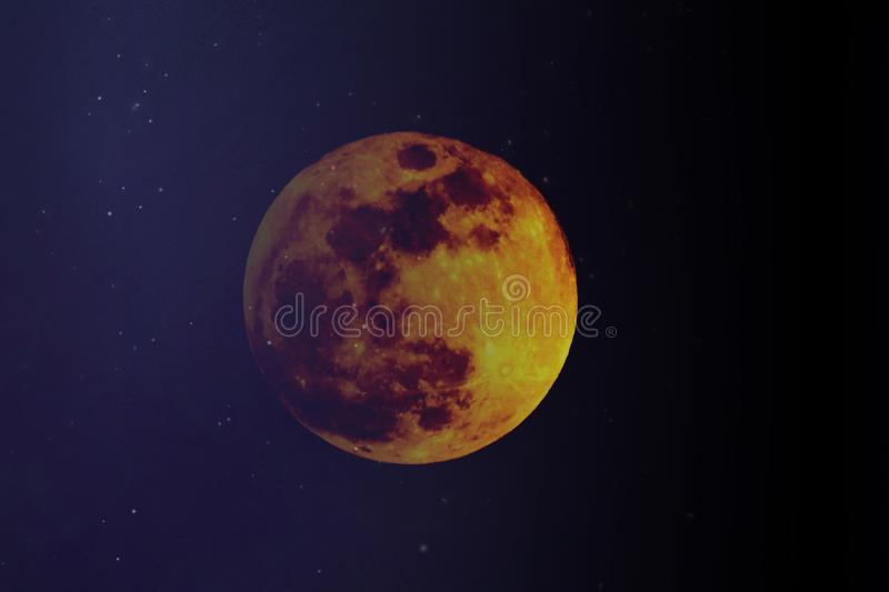 Big full colourful yellow red moon in dark blue sky and  some stars. Big full colourful yellow red moon in dark navy  blue sky and  some stars. Moon, sky stock photography