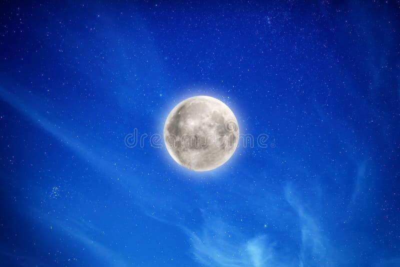 Big full moon on night sky with stars stock image