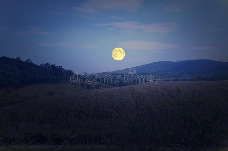 Big full moon over the mountain. Beautiful full moon over the mountain in winter royalty free stock photo