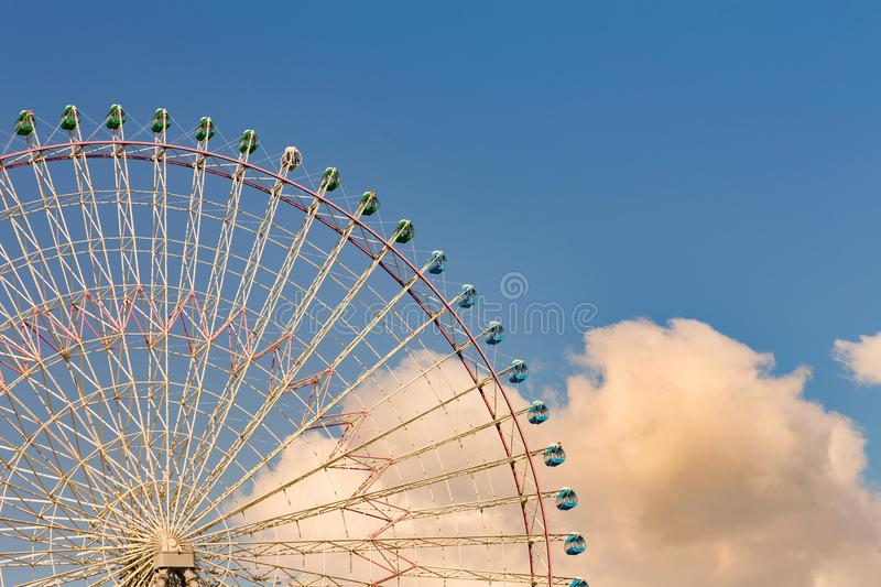 Big funfair ferris wheel with blue sky royalty free stock images