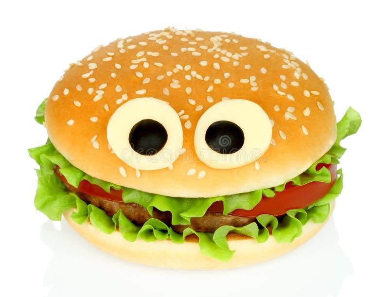 Big funny hamburger whith cheese eyes stock image