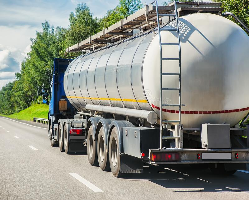 gas-tank truck goes on highway stock photos