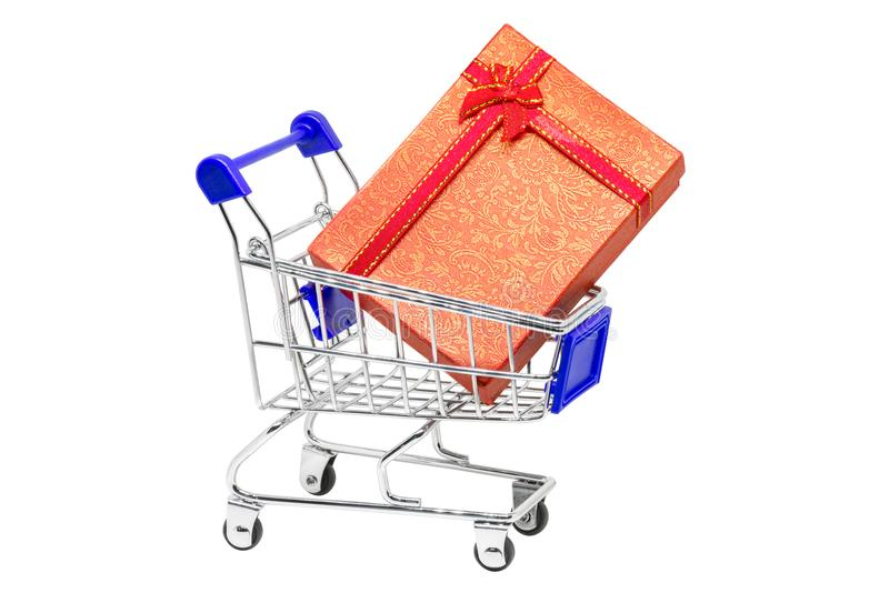 Big gift in a shopping cart. White background royalty free stock photo