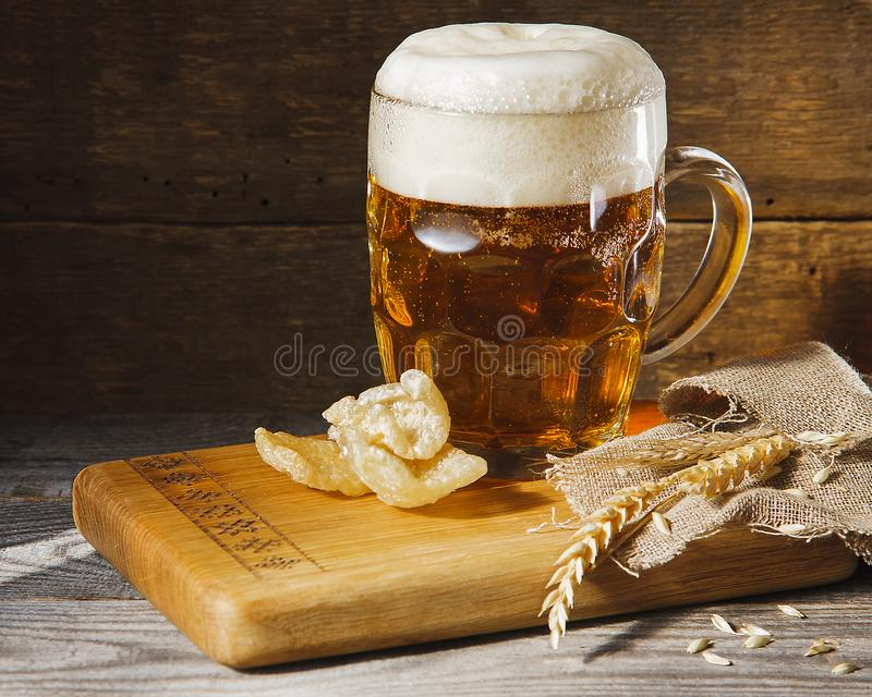 Glass of beer and snakes stock photos