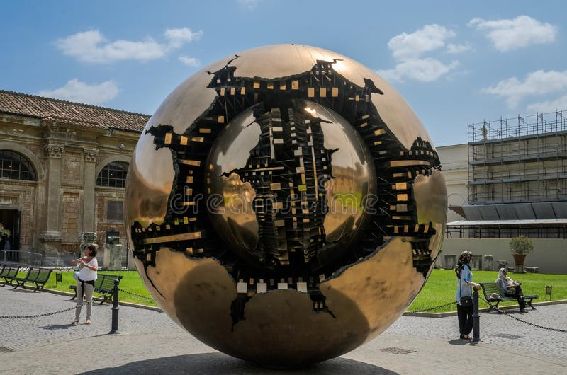ROMA, ITALY - AUGUST 2018: The big golden ball in the courtyard of the Vatican Museum royalty free stock images
