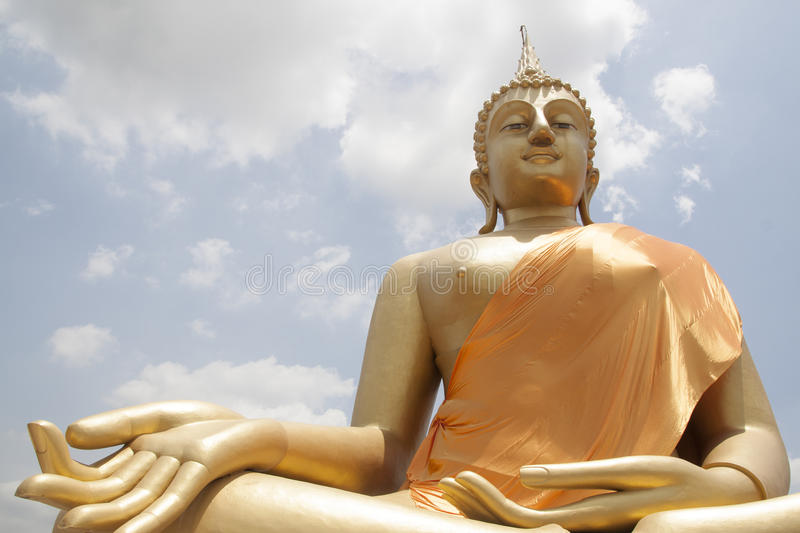 Big golden Buddha statue. In blessing posture royalty free stock photos