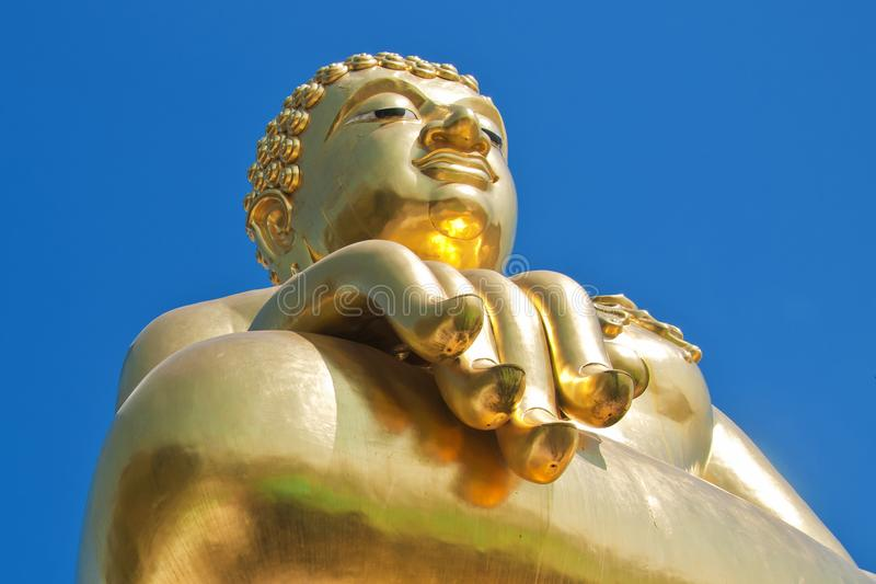 Big golden buddha statue with blue sky royalty free stock photo