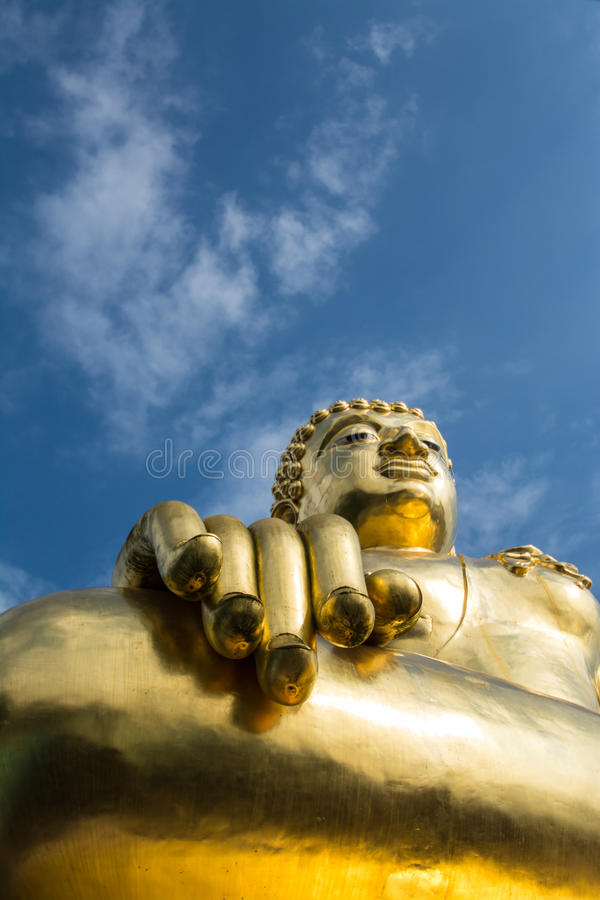 Big golden buddha statue with blue sky at Golden Triangle, Thailand royalty free stock photo