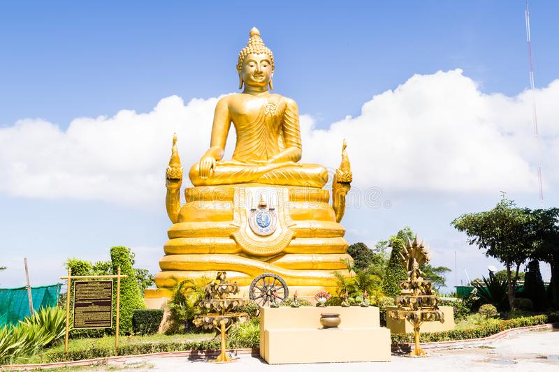 The big golden Buddha statue on hill, Phuket, Thailand. Beautiful golden Buddha inside the temple of popular and largest Bid stock photography
