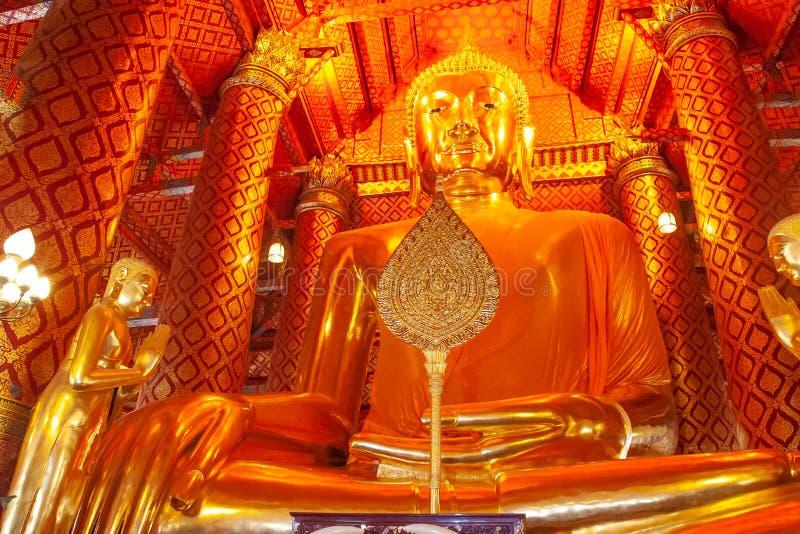 Big golden Buddha statue in temple at Wat Panan Choeng temple, Ayutthaya,Thailand. World Heritage Site.  royalty free stock photos