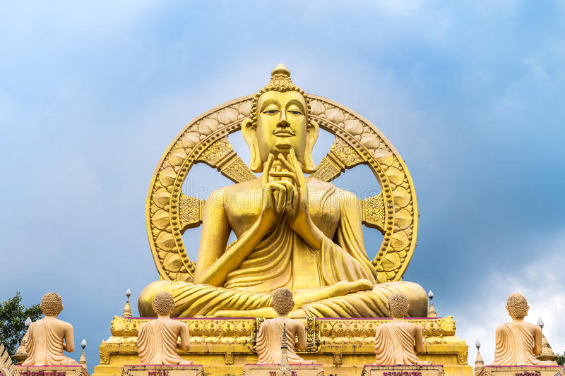 Big golden buddha statue with wheel of dhamma stock image