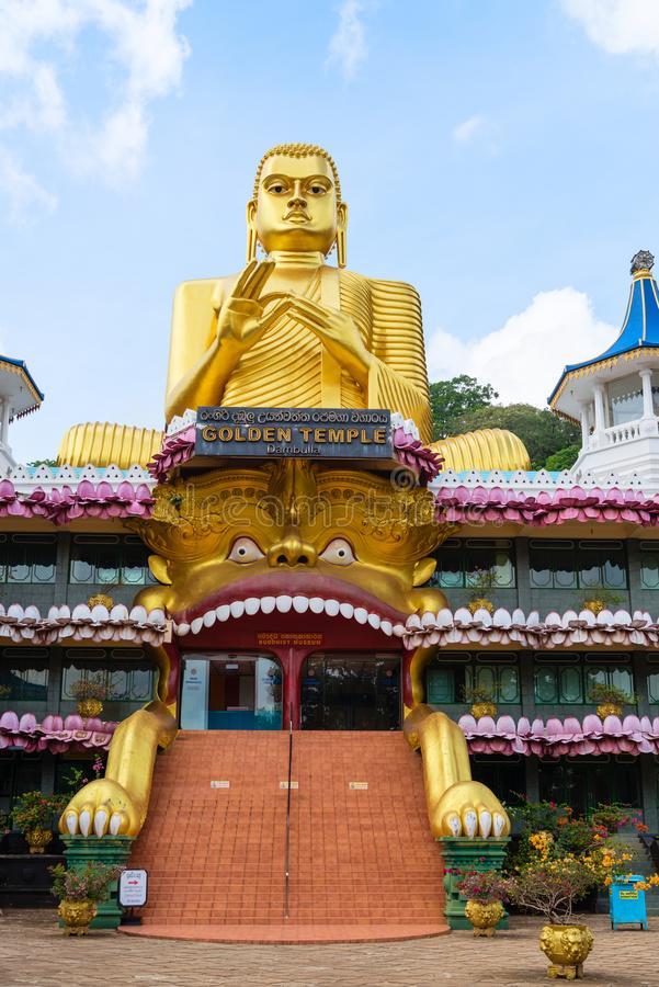 Big golden Buddha statue in wheel-turning pose in Dambulla Golden temple. Big golden Buddha statue in wheel-turning pose on the top of Golden temple and museum royalty free stock images