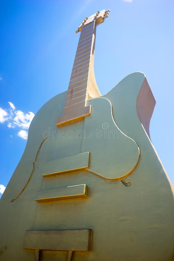 The Big Golden Guitar Tamworth Australia. One of Australia`s tourist attractions is the Big Golden Guitar. It is located in the suburb of Tamworth in New South stock photography