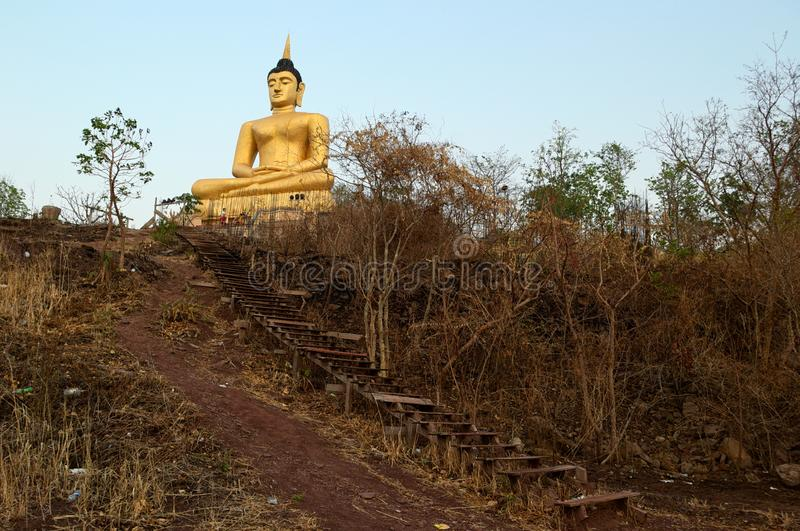 Big golden sitting Buddha statue on the hill stock photography