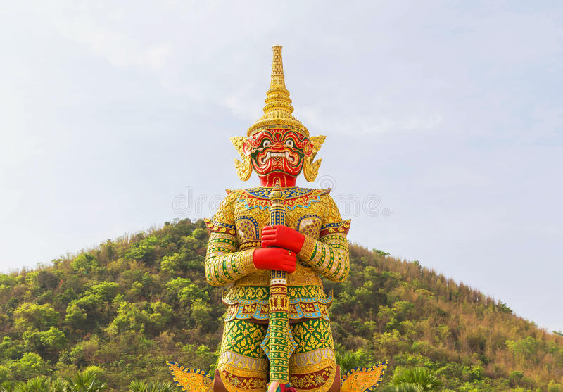 Big golden thai giant statue stand in thai temple. Big golden thai giant statue stand protection in thai temple royalty free stock photo