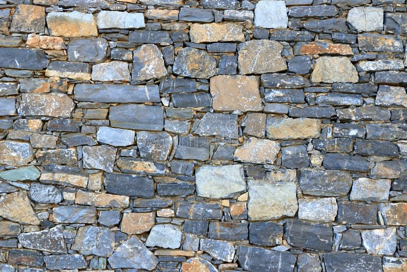 Big gray wall from stone bricks royalty free stock image