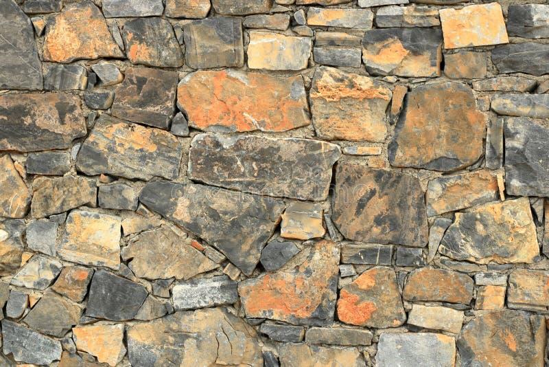 Big gray wall from stone bricks stock photography