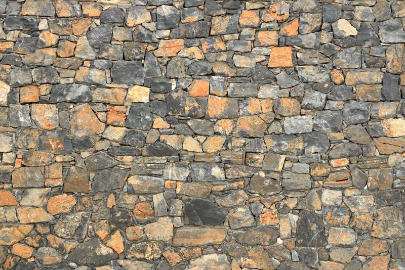 Big gray wall from stone bricks stock photos