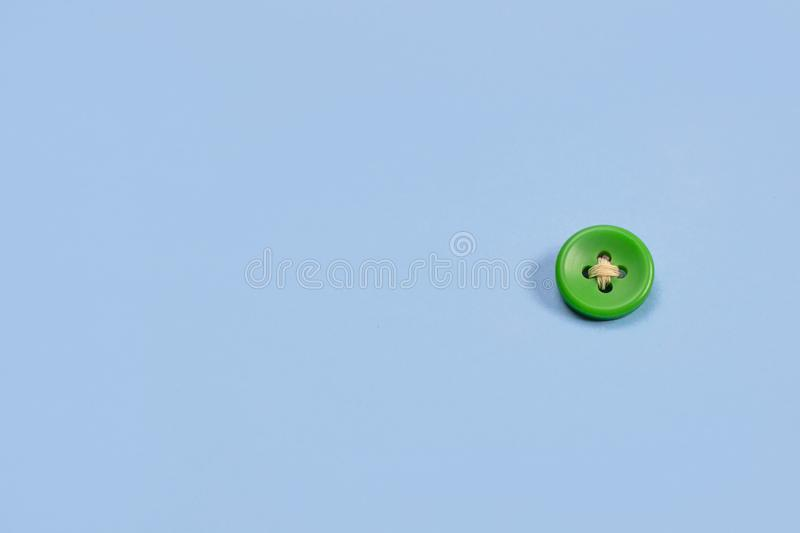 Big green button on a blue background.  royalty free stock photo