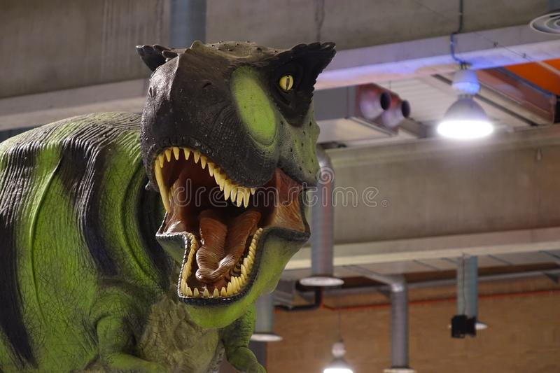 GREEN DINO WITH OPEN MOUTH royalty free stock photo