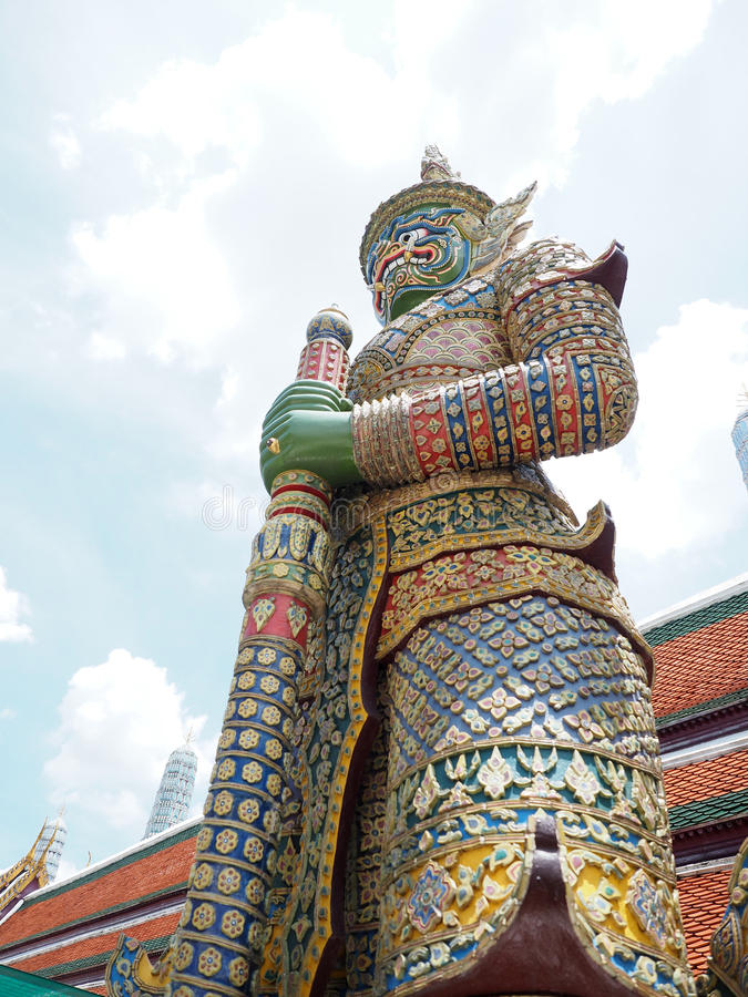 Big green giant statue stand with sunshine. At thailand temple holiday travel trip stock photos
