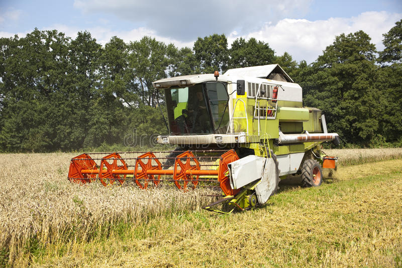 Download A big green harvester stock photo. Image of machine, natural - 13256366