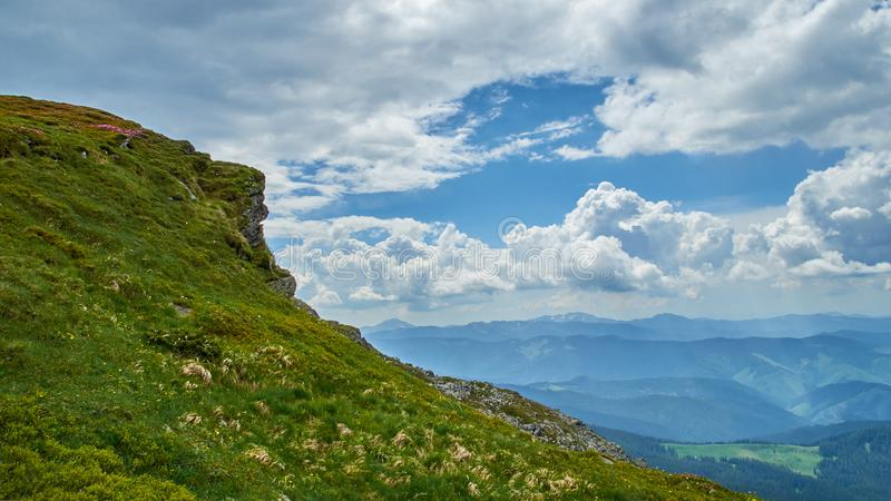 A big green hill in Carpathian mountains in the summer. Mountains landscape background. royalty free stock photo