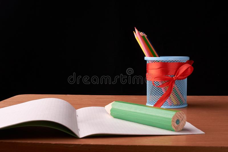 Big green pencils on color pencils in tin can background. Big green pencils on color pencils in tin can stock photos
