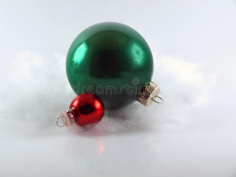 Big Green and Small Red Round Christmas Ornaments royalty free stock image