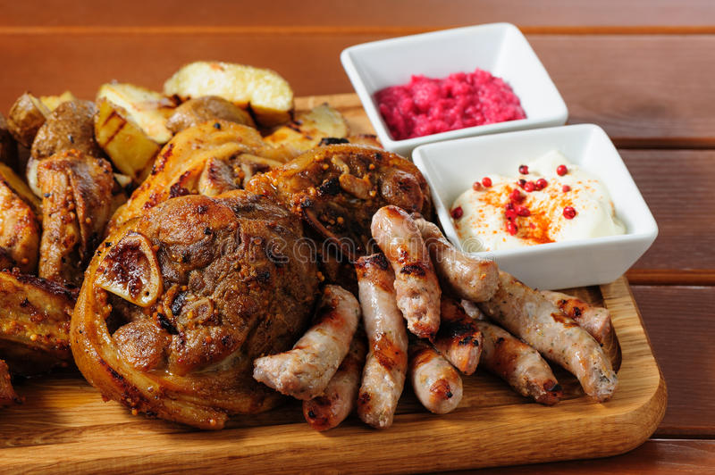 Big grilled meat and vegetables board stock photos