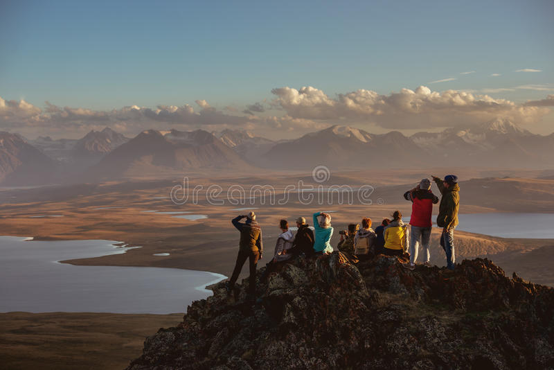 Big group of friends on mountains top stock photography
